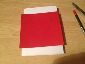 Draw a heart on a piece of red card.