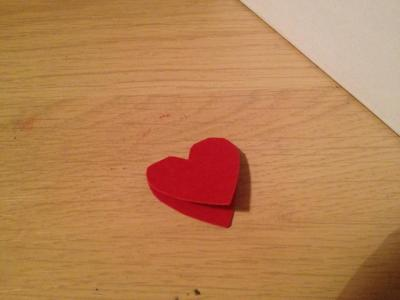 Fold a piece of red card in half and cut out a heart shape.